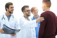 Doctors congratulating the patient`s recovery. Smiling doctors congratulating the patient`s recovery royalty free stock images