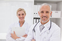 Smiling doctors coworker standing Stock Images
