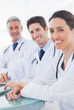 Smiling doctors looking at camera Royalty Free Stock Photography