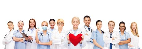 Smiling doctors and nurses with red heart Royalty Free Stock Photo