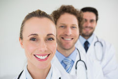 Smiling doctors in a row Royalty Free Stock Images