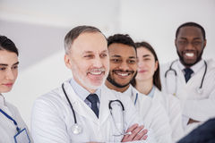 Smiling doctors standing in polyclinic Royalty Free Stock Photo