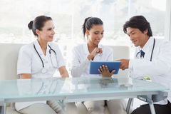 Smiling doctors using a tablet pc Stock Image