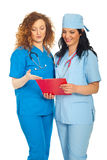 Smiling doctors women reading clipboard Stock Image
