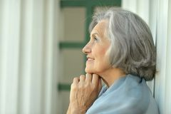 Smiling dreaming senior woman Royalty Free Stock Image