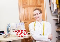 Smiling dressmaker Stock Images