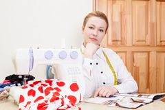 Smiling dressmaker Stock Image