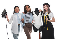 Smiling dressmakers holding tailor tools while working with white bodysuit on dummy Royalty Free Stock Photo