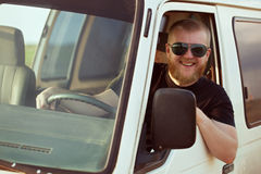 Smiling driver driving a car. Smiling driver in sunglasses driving a car Stock Images