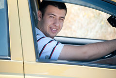 Smiling while driving. A young man smiling from his car Royalty Free Stock Photos