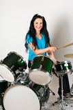 Smiling drummer. Beautiful smiling drummer woman playing and have fun with drums set,check also royalty free stock images