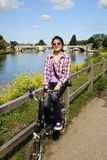 Smiling East Asian Woman with Bicycle on sunny day Royalty Free Stock Photos