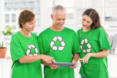Smiling eco-minded colleagues using tablet Royalty Free Stock Images