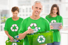 Smiling eco-minded man holding recycling box Royalty Free Stock Images