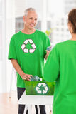 Smiling eco-minded man with recycling box Royalty Free Stock Photos