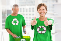 Smiling eco-minded woman doing thumbs up Stock Photos