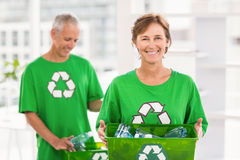 Smiling eco-minded woman holding recycling box Stock Photography