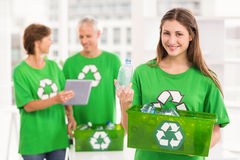 Smiling eco-minded woman holding recycling box Royalty Free Stock Image