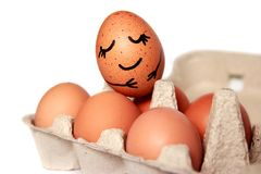 Smiling egg in the egg pack on white background.  royalty free stock photo