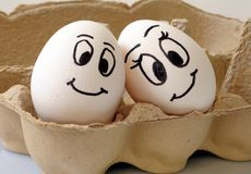Smiling eggs Stock Images