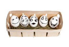 Smiling eggs in basket Stock Photo
