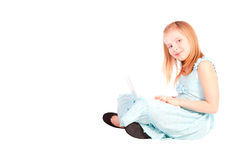 Smiling eight years old girl working with computer Stock Image