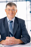Smiling Elder Businessman. Stock Photo