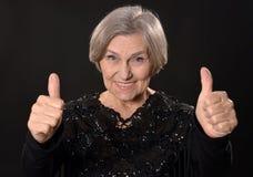 Smiling elder woman Stock Images