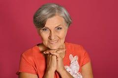 Smiling elder woman Stock Image