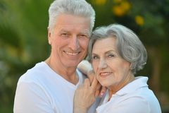 Smiling elderly couple outdoors Royalty Free Stock Images
