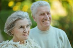 Smiling elderly couple outdoors Stock Photo