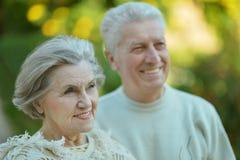 Smiling elderly couple outdoors Stock Photo