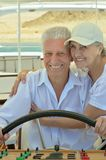 Smiling elderly couple resting on yacht. In sea royalty free stock photos
