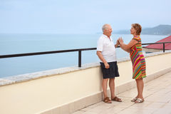 Smiling elderly couple on veranda near seacoast Royalty Free Stock Photo