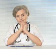 Smiling elderly doctor Stock Photos
