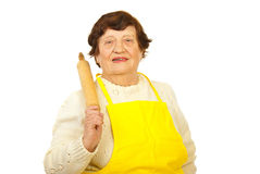 Smiling elderly holding rolling pin Stock Images