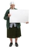Smiling elderly lady holding blank sheet in hands. Over white Royalty Free Stock Images