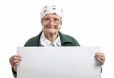 Smiling elderly lady holding blank sheet in hands. Over white Stock Images