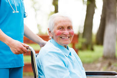 Smiling Elderly Lady in Wheelchair Royalty Free Stock Images