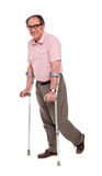 Smiling elderly man with crutches Stock Photography