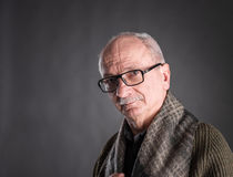 Smiling elderly man in glasses Royalty Free Stock Images