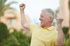 Smiling Elderly man Stock Photo