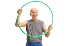 Smiling elderly man holding a hula hoop and looking at the camera. Isolated on white background royalty free stock photo