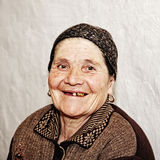 Smiling elderly woman Stock Image