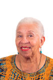 Smiling elderly woman. Elderly African American woman smiling from a pleasant surprise Royalty Free Stock Photography