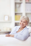 Smiling elderly woman Stock Photos