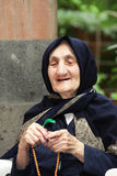 Smiling elderly woman with beads Stock Photos