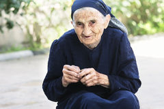Smiling elderly woman with cherry Stock Images