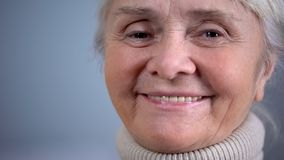 Smiling elderly woman close-up, social security, care in old age, positive mood. Stock photo royalty free stock images