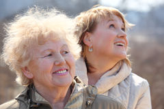 Smiling elderly woman and her daughter stock photos